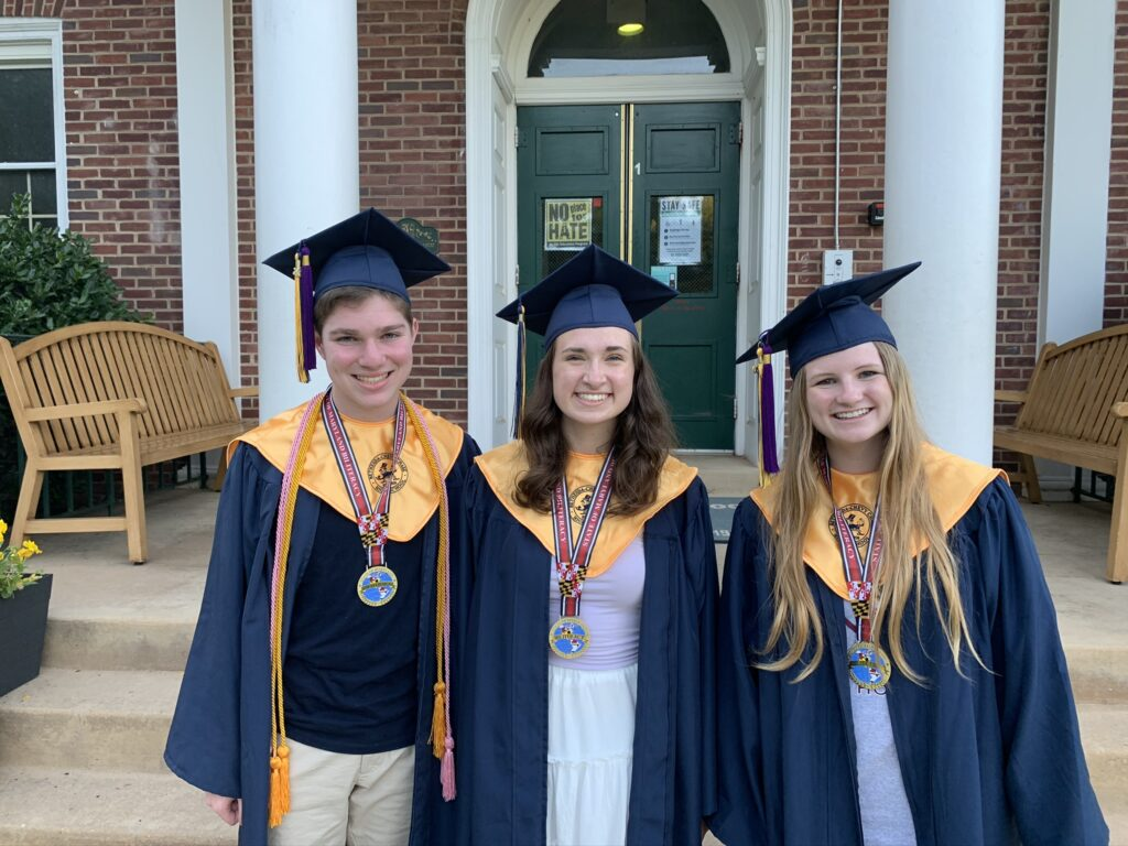 The author, age 18, with two friends, in graduation caps and gowns