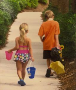 The author and his sister walking to the beach.